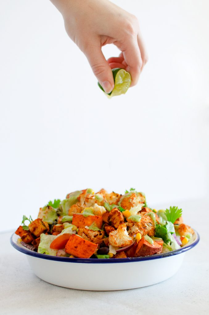 Squeezing lime on the Vegan Mexican Salad recipe by Lovely Jubley