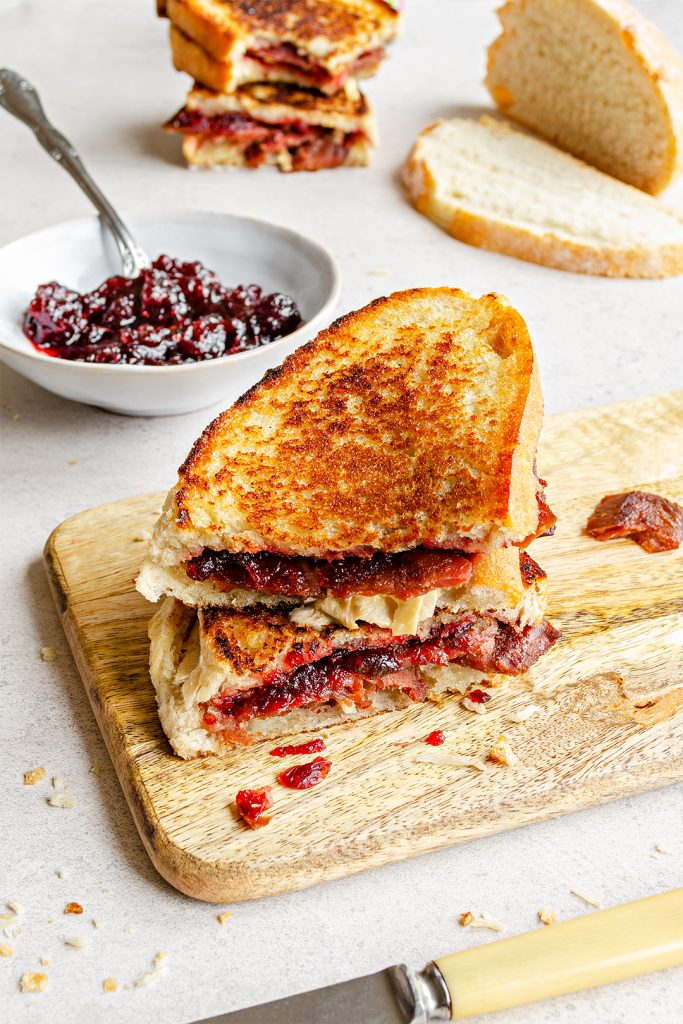 Vegan bacon, cranberry and camembert cheese bacon toastie oozing vegan cheese