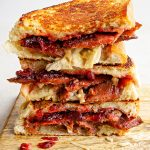 Vegan bacon cranberry and camembert cheese toastie stacked up