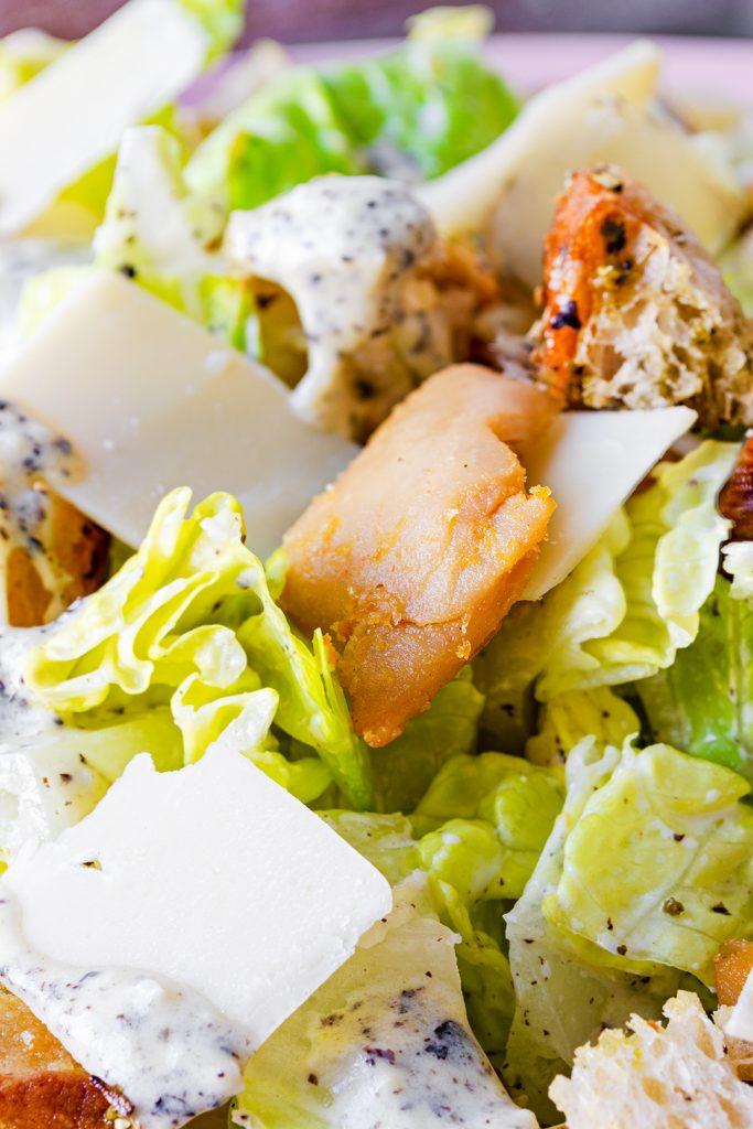 close up image of a vegan chicken caesar salad