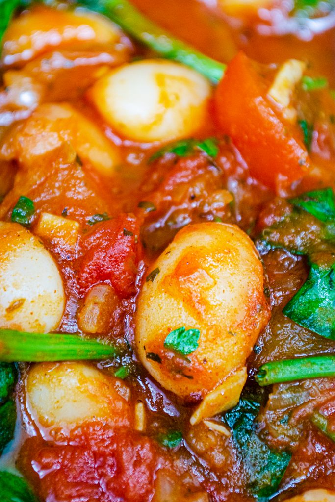 Close up of the cannelini beans cooking in the vegan shakshuka