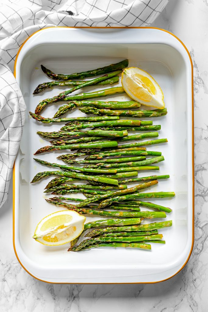 A baking tray of delicious lemony roasted asparagus